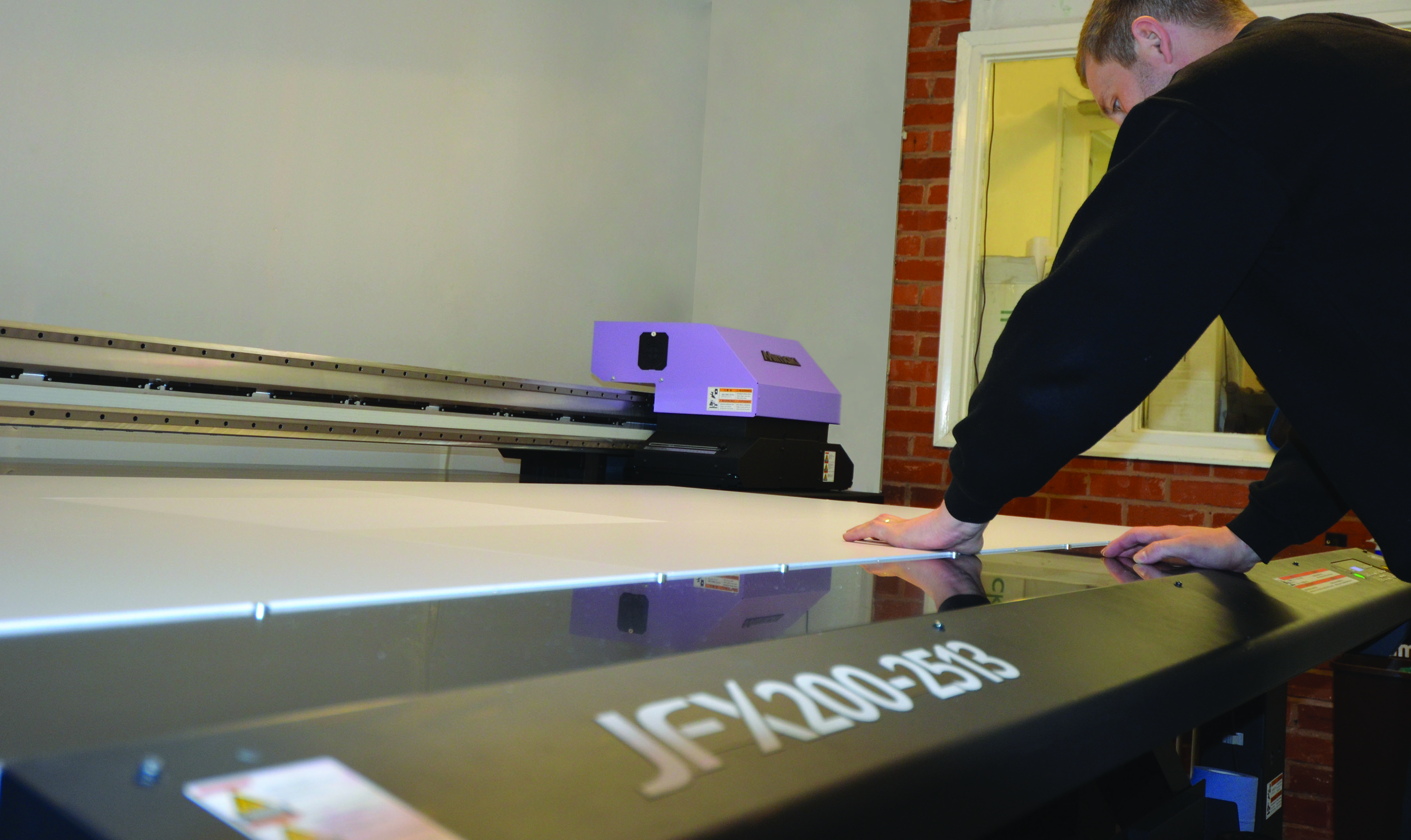Matt Shaw sets up a new print job on the Mimaki JFX200