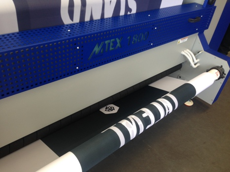 Hanging fabric banners in production on the MTEX 1800 direct-to-textile printer