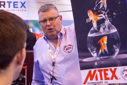 MTEX Technologies MD Stewart Bell shows the density of the black in a backlit image at Sign & Digital UK