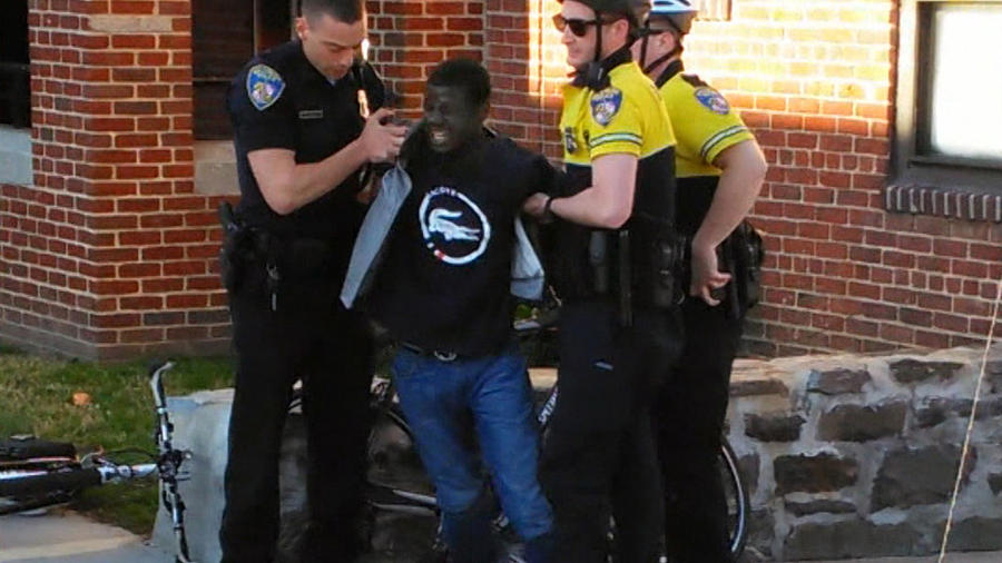 Freddie Gray is seen being taken into custody by Baltimore Police on April 12 in this still from a cell phone video. (Baltimore Sun)
