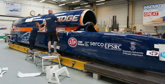 PressOn team installing graphics on Bloodhound SSC