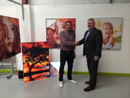DPI's Stewart Bell (right) welcomes new director Simeon Wicks, with Primex frames on show in the background